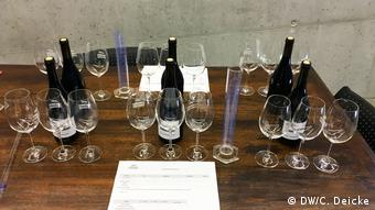 Wine botles and glasses on a table, ready for the winemaking workshop