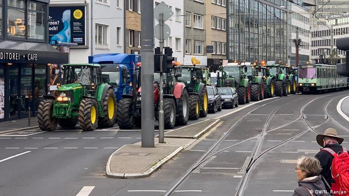 Farmers drive their tractors in Bonn