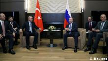 Turkish President Tayyip Erdogan meets with his Russian counterpart Vladimir Putin in Sochi, Russia, Turkey, October 22, 2019. Mustafa Kamaci/Turkish Presidential Press Office/Handout via REUTERS ATTENTION EDITORS - THIS PICTURE WAS PROVIDED BY A THIRD PARTY. NO RESALES. NO ARCHIVE