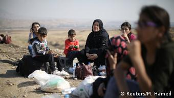 Курдские беженцы на границе Сирии с Ираком