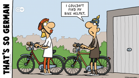 Fernandez cartoon That's so German Two cyclists, one with helmet and the other with aPickelhaube