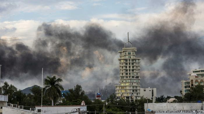 Smoke seen in the background of buildings