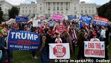 TOPSHOT - Supporters of US President Donald Trump hold a Stop Impeachment rally in front of the US Capitol October 17, 2019 in Washington, DC. (Photo by Olivier Douliery / AFP) (Photo by OLIVIER DOULIERY/AFP via Getty Images)