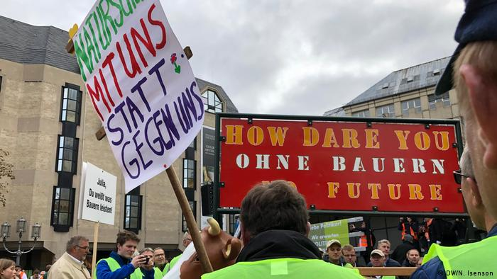 A sign at the Bonn protest reads: How dare you. Without farmers, no future