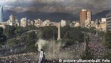 Demonstrators protest in Plaza Italia during an anti-government march in Santiago, Chile, Tuesday, Oct. 22, 2019. Unrest began last week when a rise in subway fares led to student protests, but then spread nationwide, fueled by frustration among many Chileans who feel they have note shared in the economic advances in one of Latin America's wealthiest nations.(AP Photo/Esteban Felix) |