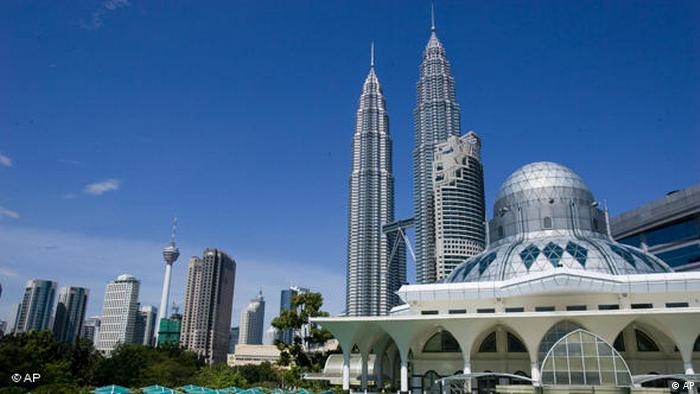 Malaysia's landmark Petronas Twin Tower and KL Tower stand in the Kuala Lumpur city center, in this February 22, 2006, file photo, AP.