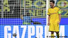 Dortmund's German defender Mats Hummels reacts after Dortmund conceded their second goal during the UEFA Champions League Group F football match Inter Milan vs Borussia Dortmund on October 23, 2019 at the San Siro stadium in Milan. (Photo by Marco Bertorello / AFP)