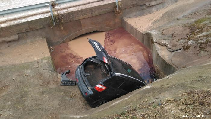 A car swept into a hole in the road in Spain