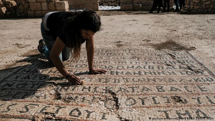 Employees of the Israel Antiquities Authority work to uncover a 1500 year old church