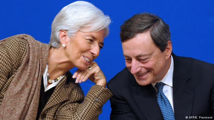 Christin Lagard and Mario Draghi exchanging small talk