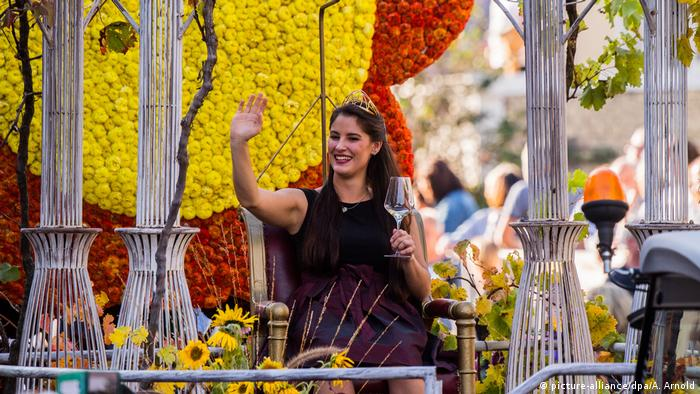 German wine queen waving from a parade float