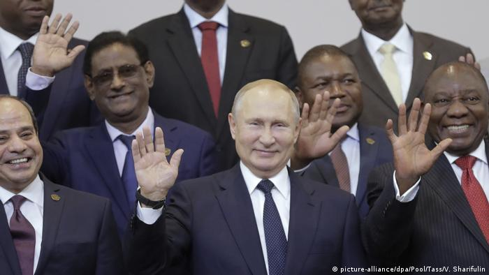 Russian President Vladimir Putin stands amid African heads of state
