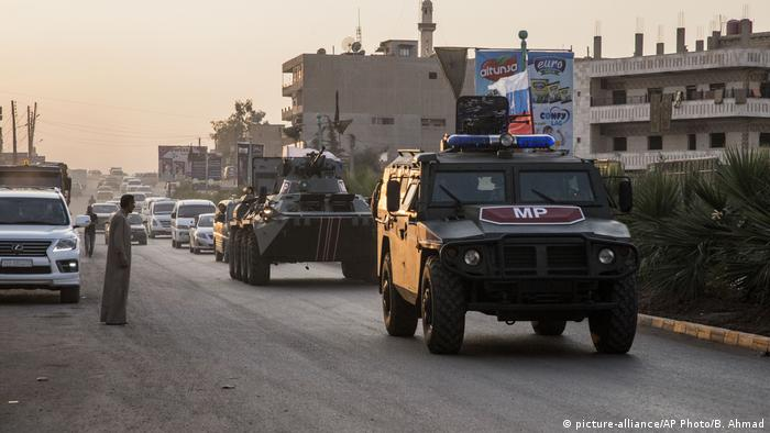 A Russia armoured 4x4 patrols in Syria