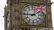 A Union flag is seen flapping in the wind in front of one of the faces of the Great Clock atop the landmark Elizabeth Tower that houses Big Ben at the Houses of Parliament in London on June 27, 2016. Top Brexit campaigner Boris Johnson sought Monday to build bridges with Europe and with defeated Britons who voted to remain in the EU in last week's historic referendum. London stocks sank more than 0.8 percent in opening deals on Monday, despite attempts by finance minister George Osborne to calm jitters after last week's shock Brexit vote. / AFP / JUSTIN TALLIS (Photo credit should read JUSTIN TALLIS/AFP/Getty Images)