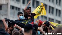 Supporters of Lebanon's Hezbollah leader Sayyed Hassan Nasrallah carry the party's flag in Beirut, Lebanon, October 25, 2019. REUTERS/Mohamed Azakir