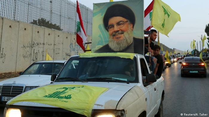 Car decorated with Lebanese, Hezbollah flags