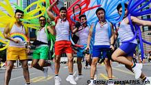 Participants jump in a pose while taking part in the annual gay pride parade in Taipei on October 26, 2019. - Thousands including members of the LGBT community on October 26 took part in the first gay pride parade held after Taiwan earlier this year legalised same-sex marriages, the culmination of a three-decade fight for equality. (Photo by Sam YEH / AFP) (Photo by SAM YEH/AFP via Getty Images)