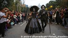 People dressed as Catrinas parade down Mexico City's iconic Reforma avenue during celebrations for the Day of the Dead in Mexico, Saturday, Oct. 26, 2019. (AP Photo/Ginnette Riquelme) |