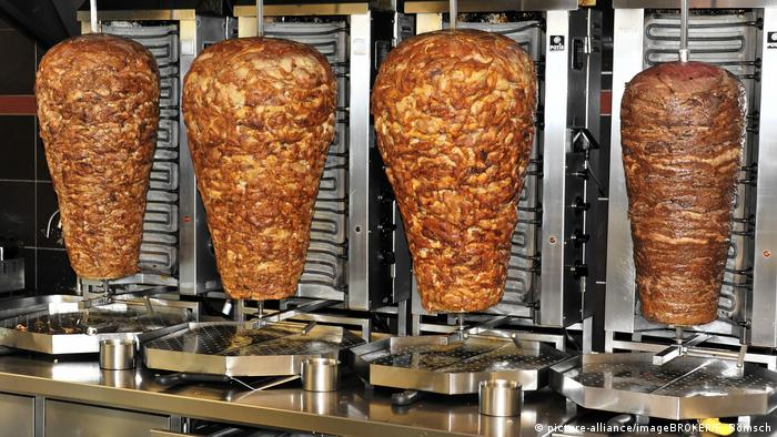 A row of Doner kebab rotisseries