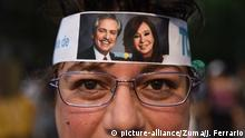 October 27, 2019: INT. WorldNews. October 27, 2019. City of Buenos Aires, Argentina.- Supporters of the Frente de Todos party wating for the results outside the bunker in city of Buenos Aires, Argentina, on October 27, 2019..A woman with a bandana in her head with the picture of Alberto Fernandez and Cristina Fernandez de Kirchner, candidates for president and vicepresident. (Credit Image: © Julieta FerrarioZUMA Wire |