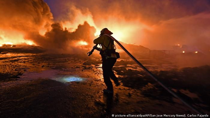 Silhouette of a firefighter against the backdrop of a fire