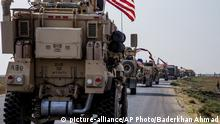 U.S. military convoy drives near the town of Qamishli, north Syria, Saturday, Oct. 26. 2019. A U.S. convoy of over a dozen vehicles was spotted driving south of the northeastern city of Qamishli, likely heading to the oil-rich Deir el-Zour area where there are oil fields, or possibly to another base nearby. The Syrian Observatory for Human Rights, a war monitor, also reported the convoy, saying it arrived earlier from Iraq. (AP Photo/Baderkhan Ahmad) |