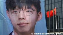 A promotional election campaign poster of Hong Kong democratic activist, Joshua Wong is displayed in Hong Kong, Saturday, Sept. 28, 2019. Joshua Wong announced that he will run for 2019 District Council Election in Hong Kong on behalf of the South Horizons Community. Various political activist attended the presser in support of his decision. (AP Photo/Kin Cheung)  