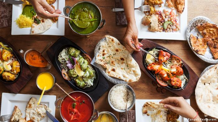 Indian curry dishes on a table in a restaurant