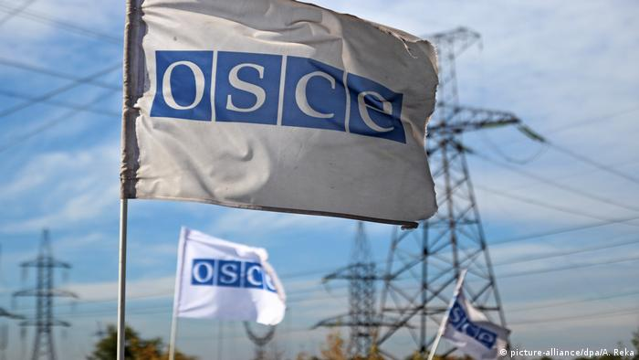 OSCE flag near the town of Zolote