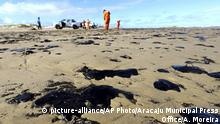 In this Oct. 4, 2019 handout photo released by the Aracaju Municipal Press Office, workers remove oil from Viral Beach, in Aracaju, Brazil. The oil that has been polluting Brazil's northeastern beaches since early September is likely coming from Venezuela, according to a report by Brazil's state oil company cited by the country's environment minister. The oil sludge has now reached 61 municipalities in nine Brazilian states, contaminating over 130 beaches, in what Brazilian officials have called an unheard of disaster. (Andre Moreira/Aracaju Municipal Press Office via AP) |