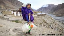 09.10.2019 *** Kalzang Palmo, 30, walks to collect water from the village tap in Pangmo, where water is pumped up from the Spiti River below.