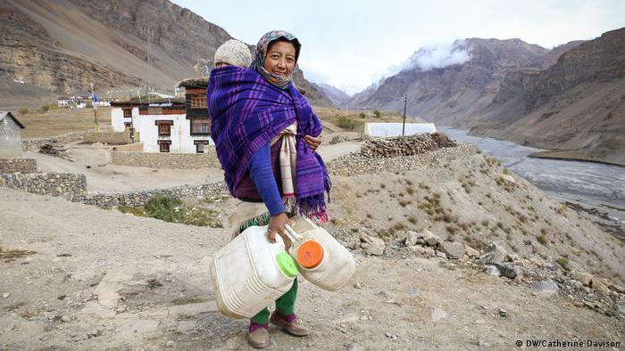 A woman standing in the Spiti region, Himalayas in India
