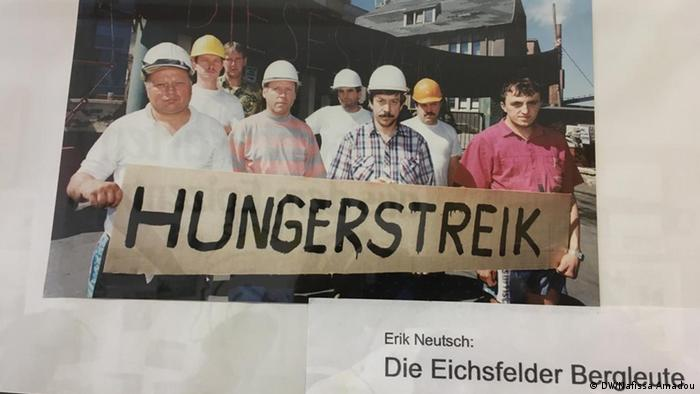 A picture showing protesting striking 30 years ago and holding up a sign advertising their hunger strike