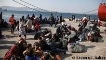 Refugees and migrants wait to be transferred to camps on the mainland, at the port of Elefsina near Athens Greece, October 22, 2019. REUTERS/Costas Baltas