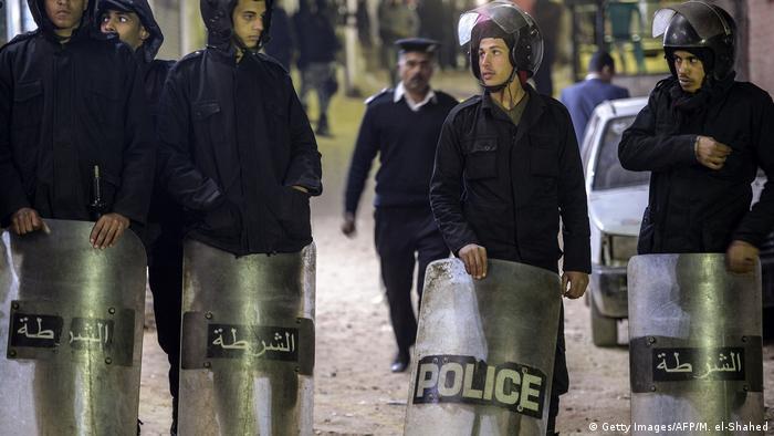 Egyptian police guard a street