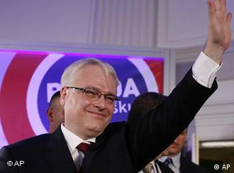 Croatian presidential candidate Ivo Josipovic of Social Democrats gestures, after receiving exit polls results at his campaign headquarters in Zagreb, Croatia, Sunday, Jan. 10, 2010. An exit poll indicates a legal scholar is leading comfortably in Croatia's presidential election over Zagreb's mayor. (AP Photo/Filip Horvat)