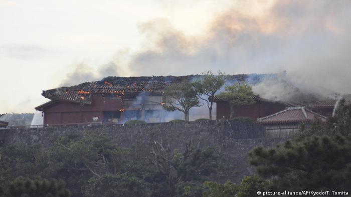 Smoke rises from Shuri Castle