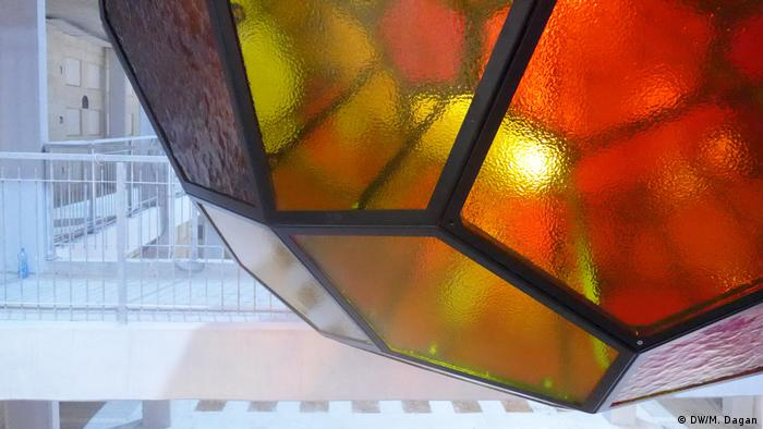 A close up of the warm-toned glass in one of Gabriel's 'light spheres'