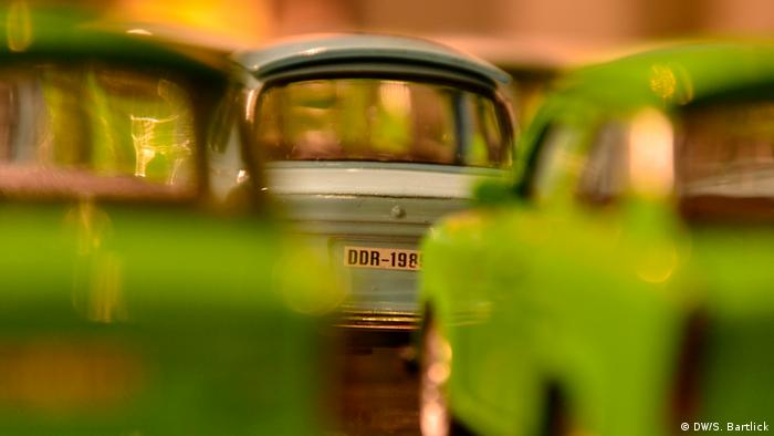 Berlin Checkpoint Charlie - close-up picture of toy Trabant cars