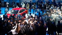 Journalists gather on stage after Ford Motor Co. introduces the next generation Ford Focus at the North American International Auto Show Monday, Jan. 11, 2010, in Detroit. (AP Photo/Carlos Osorio)