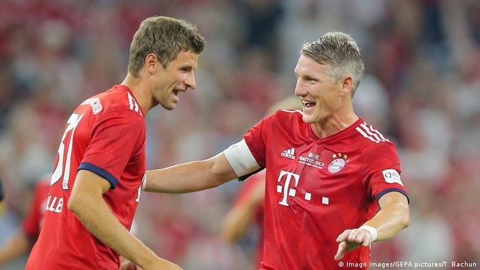 Thomas Müller and Bastian Schweinsteiger