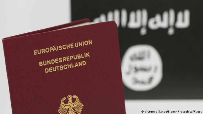 A German passport with an IS flag in the background