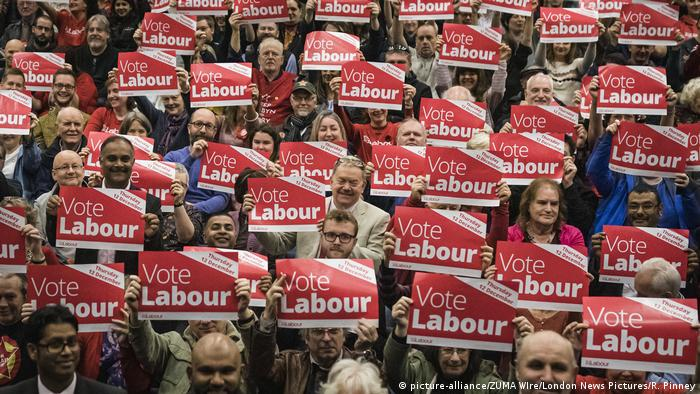 Labour Party supporters hold signs that read: Vote Labour