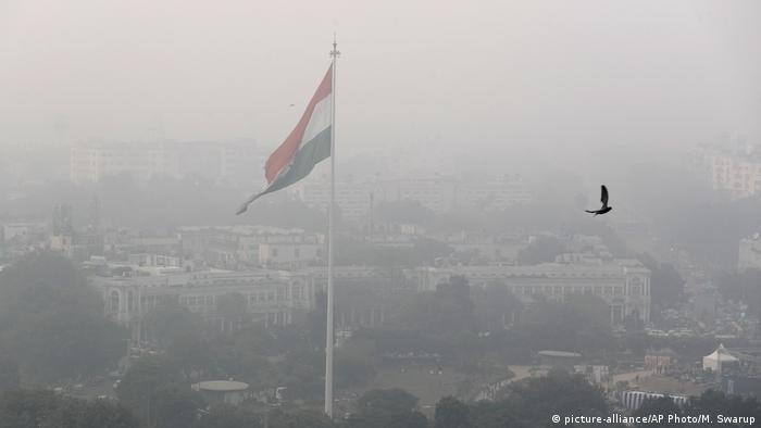 India's flag flutters in the smog