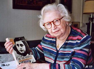 Miep Gies displays a copy of her book Anne Frank Remembered