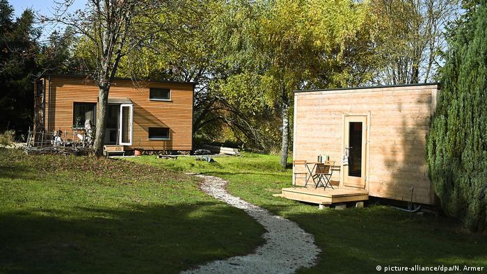 Two tiny houses among trees
