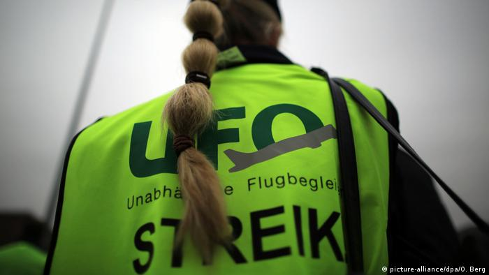 An German airline worker is seen striking in October. Dpa