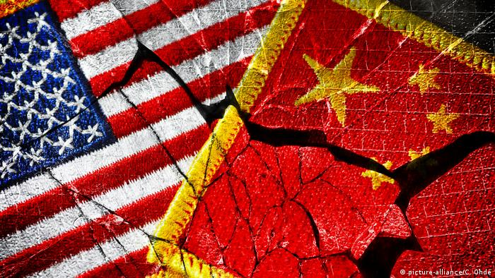 An image of severed US and Chinese flags