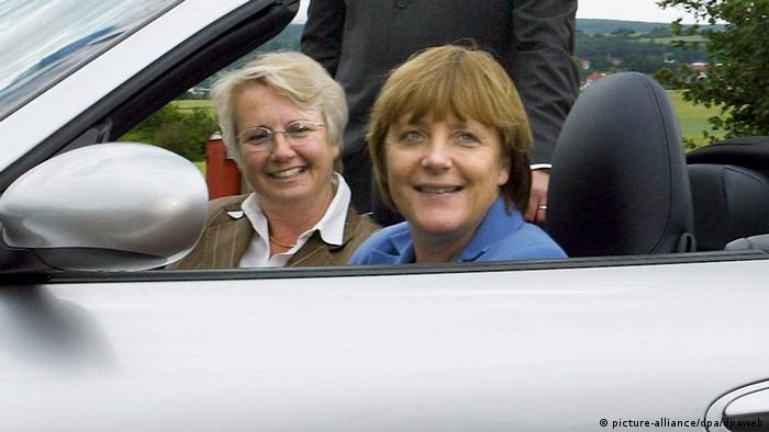 Angela Merkel in the driver's seat (next to Annette Schavan) in 2004