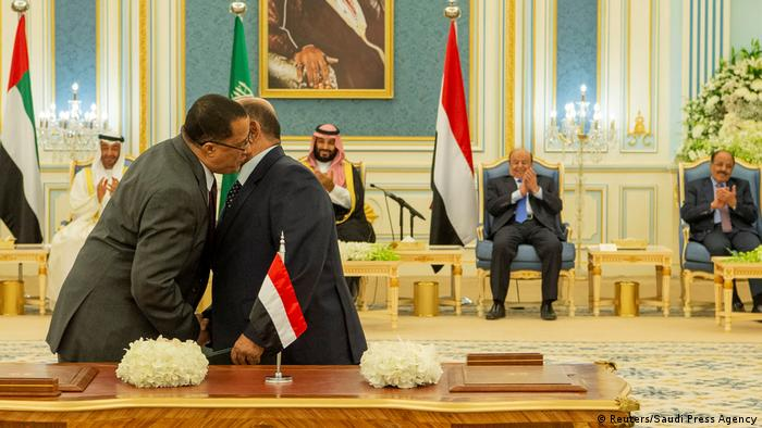 Representatives of Yemen's government and southern separatists embrace each other after signing a Saudi-brokered deal to end a power struggle in the southern port of Aden